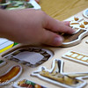 September 8, 2009.<br /> <br /> Since I posted one of Eli's photo yesterday, Noah asked me to post this one of him on his first day of school too. Before class started, he played with this puzzle with one of his friends. He had a great first day!