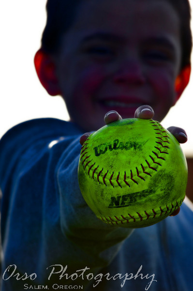 Wednesday, March 17, 2009<br /> <br /> Gabe, Noah, and I went to a girl's softball game for Salem Academy tonight. It was a beautiful day too. Noah caught one of the balls that went out-of-bounds and he was a happy camper to just play with it for a long time. I took this shot after the game was over and I right before I told him that he had to return the ball... and he could not keep it. He was OK with it and returned it after playing catch a little longer...