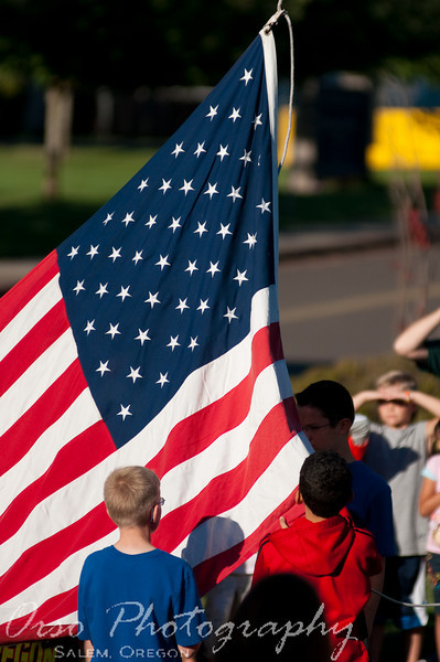 September 11, 2009.<br /> <br /> I took this photo during the Flag Ceremony at our kids' school this morning. All the students circled around the flag pole and watched, sang, and enjoyed being a part of this event.