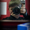 Sunday, February 8th, 2009.<br /> <br /> Eli wanted to take pictures today while we were getting our haircut; He really wanted for me to post this picture of him on the Daily Pictures gallery. He was having a good time with my camera and I was impressed on how well he was holding the camera.