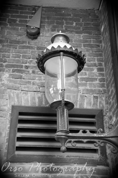 March 17, 2009.<br /> <br /> I took this picture today while downtown Salem, Oregon. This is an old street lamp/light that works on gas. I like their style and how cool they look against the bricks. This is by The Busick Court restaurant, which is a great place to eat.