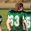 September 10, 2009.<br /> <br /> First JV football game tonight...They ended up losing, but it was a good game. Here are 3 players on the sideline, watching their team mates as they tackled down another player during the second quarter...