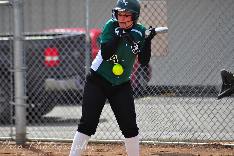 """5/8/10<br /> <br /> Bottom of the 3rd, bases loaded, Number 14 Jessie Kropf for the Salem Academy Crusaders, takes a real """"Gut Buster"""" for the team."""