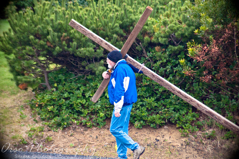 Saturday, April 11, 2009.<br /> <br /> I took this photo while at the Oregon Coast during spring break and I have been saving it for Easter weekend. Jeneé and I saw this gentleman carrying the cross down Hwy 101, and we parked across the street so that we could take this picture. We saw him again later, going the opposite direction.