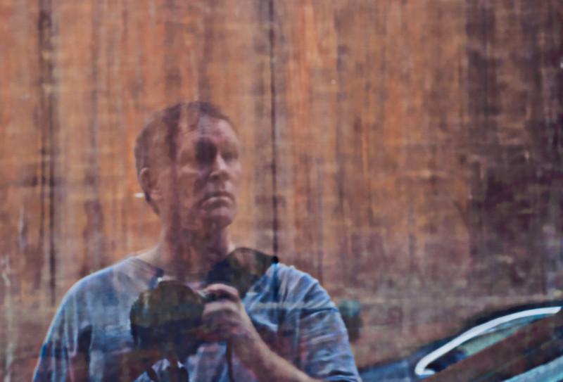 self-portrait, reflection in a window