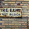 Fire Exit sign, photographed in an alley in Birmingham, AL<br /> <br /> This image is presented as photographed and uncensored. If there are objections, I will remove the image from the Daily Post gallery.
