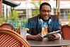 08.24.10 BALTIMORE, MD. -Mario Armstrong, Digital Lifestyle Expert, Mario Armstrong Media. Portraits using his ipad at an outdoor table at Langermann's restaurant at the Can Company Building in Canton.(Maximilian Franz/ The Daily Record)