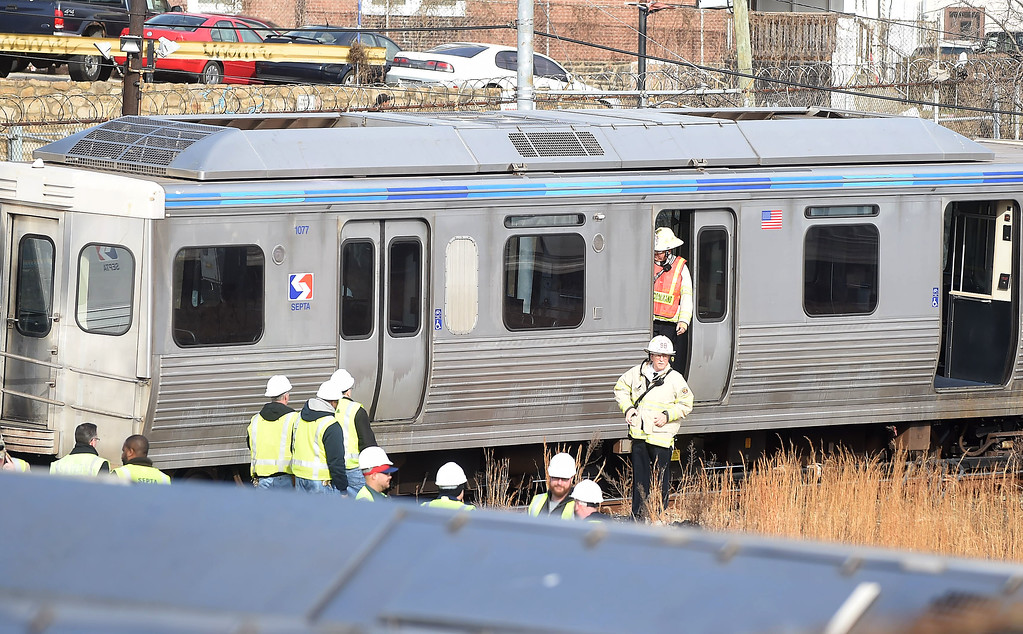 . PETE  BANNAN-DIGITAL FIRST MEDIA     Police and Septa officials at  Victory Ave. in Upper Darby, the scene where several train cars on the Market-Frankford Elevated line derailed this morning after a collision, officials said.