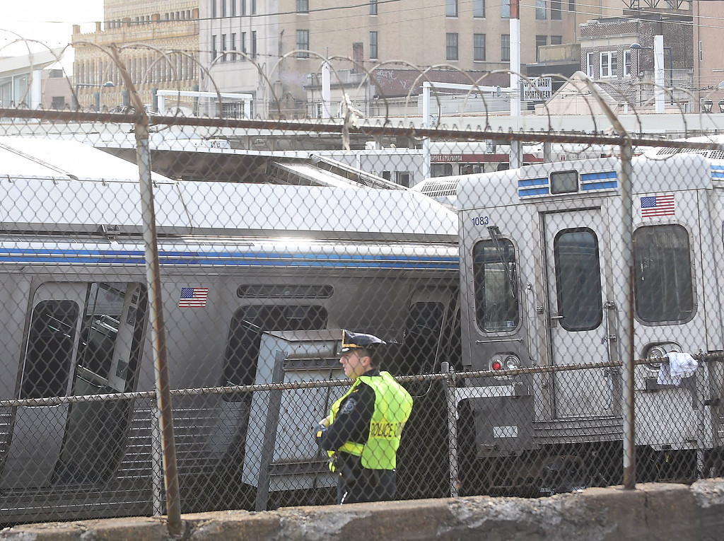 . PETE  BANNAN-DIGITAL FIRST MEDIA     Police Victory Ave. in Upper Darby, the scene where several train cars on the Market-Frankford Elevated line derailed this morning after a collision, officials said.