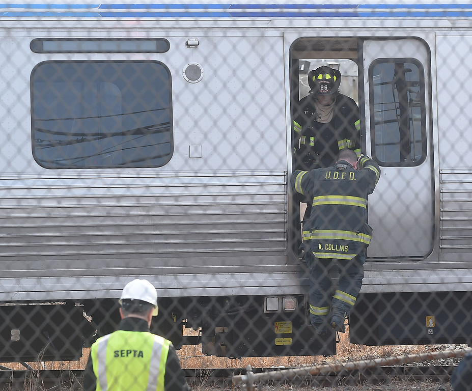. PETE  BANNAN-DIGITAL FIRST MEDIA     Police, fire and Septa officials at  Victory Ave. in Upper Darby, the scene where several train cars on the Market-Frankford Elevated line derailed this morning after a collision, officials said.