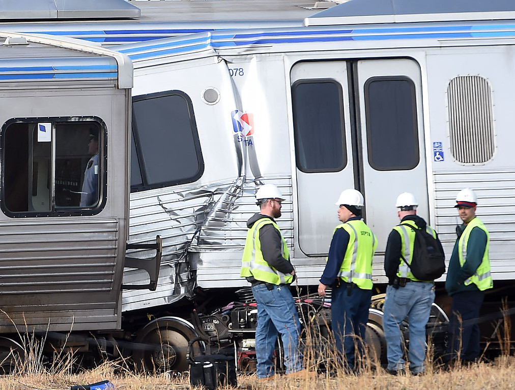 . PETE  BANNAN-DIGITAL FIRST MEDIA     Septa officials at the scene where several train cars on the Market-Frankford Elevated line derailed this morning after a collision, officials said.