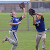 PETE BANNAN  DIGITAL FIRST MEDIA    Aston Knights second base, Mike Schmucker and right fielder Avery Frank track a fly ball in the fifth inning against Media in Intermediate EDCO baseball finals Tuesday at Buggy Field in Aston. The to collided but Schmucker hung on for the out. The Knights won 1-0 to tie the three games series.