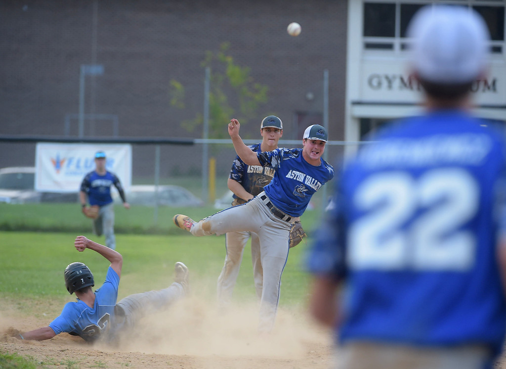 . PETE BANNAN  DIGITAL FIRST MEDIA    Aston Valley shortstop Pat McVey and first baseman (22) Jared Korenkiewicz conect for a doubleplay in the seventh inning of the Intermediate EDCO title game against Media Thursday evening at Spington Middle School. Aston won 4-1.