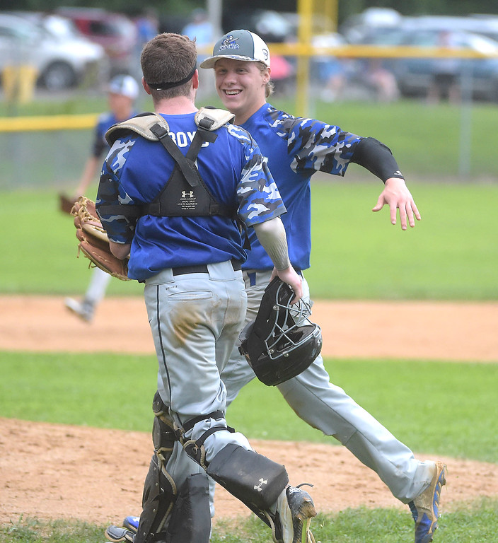 . PETE BANNAN  DIGITAL FIRST MEDIA    Aston Knights  Ryan Kester and catcher Connor Boyd enjoy their 1-0 victory  after the final out over Media in Intermediate EDCO baseball finals Tuesday at Buggy Field in Aston. Kester scored the only run in the game which tied the three game series.
