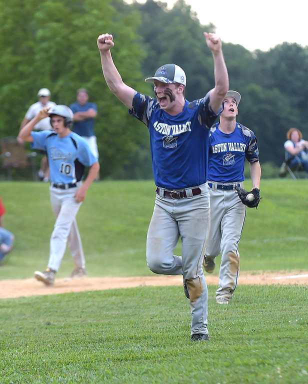 . PETE BANNAN  DIGITAL FIRST MEDIA    Aston Valley pitcher Danny Guinan celebrates the final out as the Knights won the Intermediate EDCO title over Media Thursday evening at Spington Middle School. Guinan pitched a compete game in the 4-1 victory.