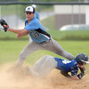 PETE BANNAN  DIGITAL FIRST MEDIA    Aston Valley runner Ryan Kester slides safely into second as Media's (37) Caleb Mahalik in the Intermediate EDCO title game Thursday evening at Spington Middle School.