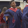 PETE  BANNAN-DIGITAL FIRST MEDIA           Joshua Shomari McCalister-Afflick lets out a whoop after graduating from Cardinal O'Hara held at the Mirenda Center at Neumann University  Wednesday morning.