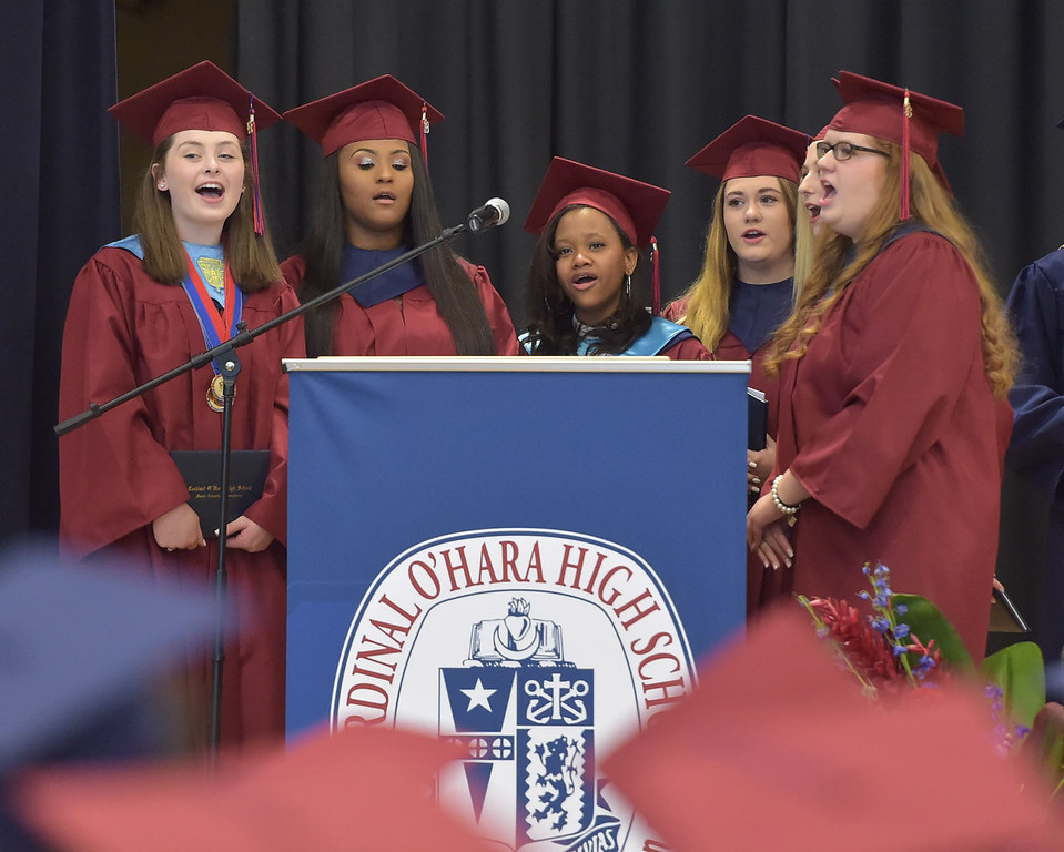 . PETE  BANNAN-DIGITAL FIRST MEDIA          Gianna Barone, Grace Grassi, DaiShona Jones, Emma Markley, Colleen Troxel and Breanna Johnson,(not in order) sing the Cardinal O\'Hara Alma Mater to end commencement at the Mirenda Center at Neumann University  Wednesday morning.