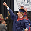 PETE  BANNAN-DIGITAL FIRST MEDIA         Stephen Shea Swanick gives a nod to family after picking up his diploma from Cardinal O'Hara  High School commencement at the Mirenda Center at Neumann University  Wednesday morning.