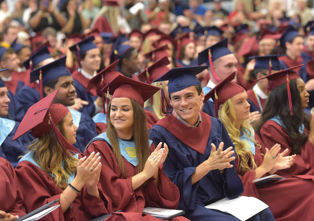 . PETE  BANNAN-DIGITAL FIRST MEDIA         Cardinal O\'Hara High School seniors break a smile after getting their diplomas during commencement held at the Mirenda Center at ewumann University  Wednesday morning.
