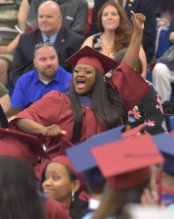 . PETE  BANNAN-DIGITAL FIRST MEDIA          A Cardinal O\'Hara senior shows her excitement after receiving her diploma Wednesday morning.