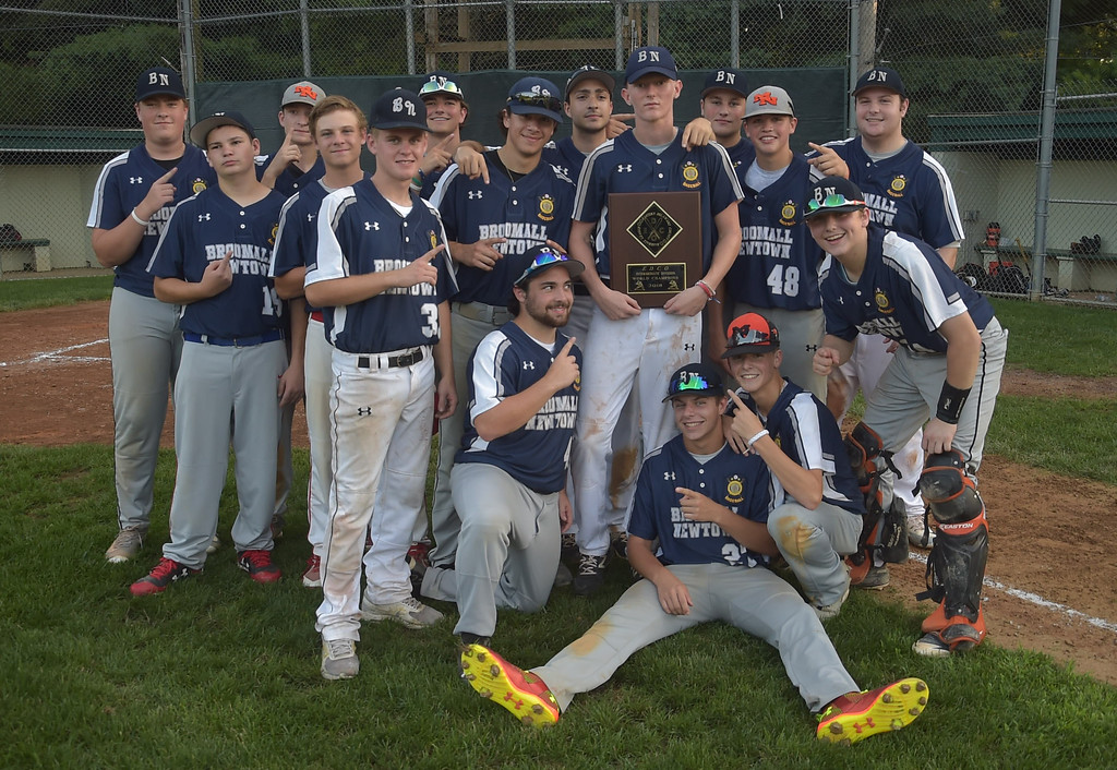 . PETE  BANNAN-DIGITAL FIRST MEDIA         Broomall-Newtown holld the EDCO title trophy after defeating Springfield two games to zero Thursday at Thomas Field in Marple.