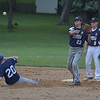 PETE  BANNAN-DIGITAL FIRST MEDIA          Broomall-Newtoen's (23) Joey Lucchesi turns the double play as Springfield's (20) Tanner Robinson slides into second.