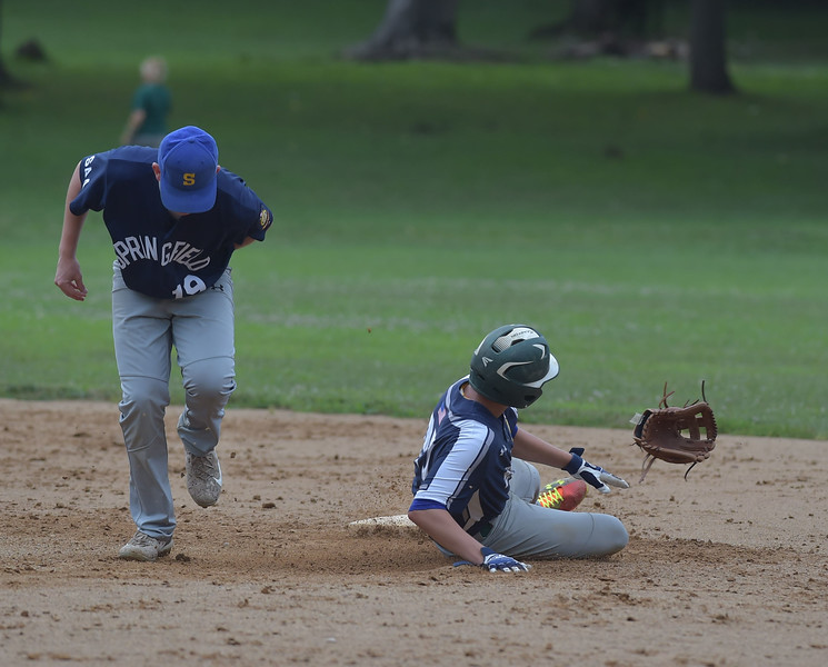 PETE  BANNAN-DIGITAL FIRST MEDIA         He lost his glove but not his arm. Broomall-Newtoen's (27) Brett Tanis slides safely into second pulling off Springfield's (19) Colin Melusky.