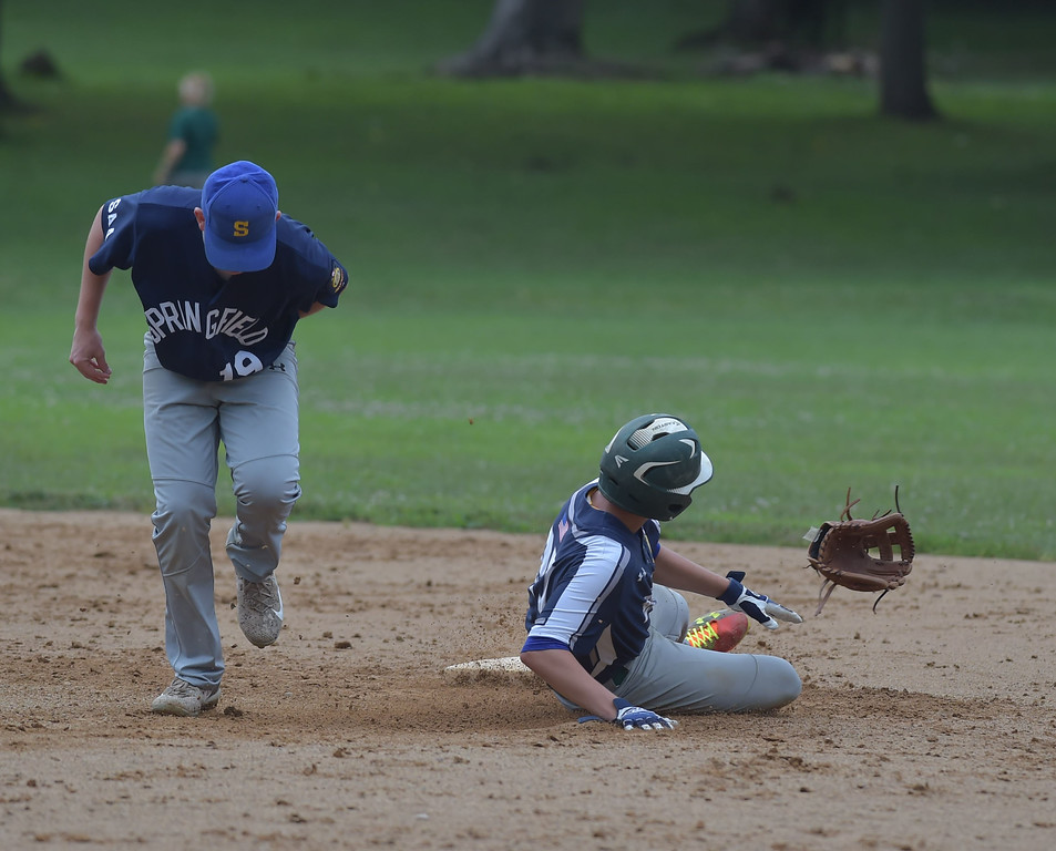 . PETE  BANNAN-DIGITAL FIRST MEDIA         He lost his glove but not his arm. Broomall-Newtoen\'s (27) Brett Tanis slides safely into second pulling off Springfield\'s (19) Colin Melusky.