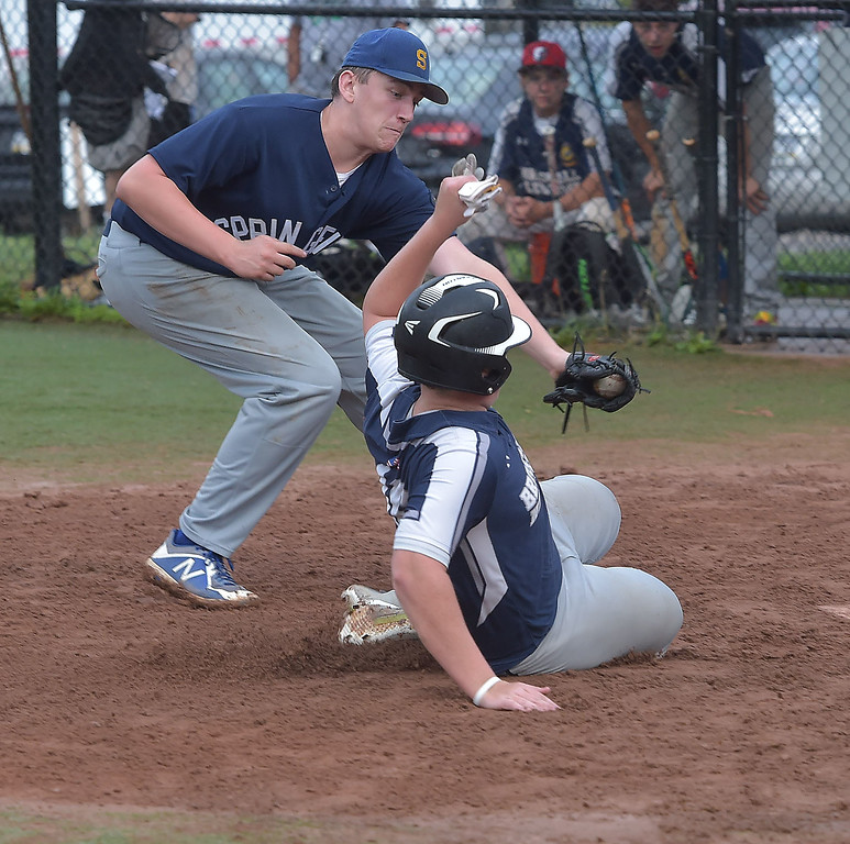 . PETE  BANNAN-DIGITAL FIRST MEDIA         Springfield pitcher (31) tags out Broomall-Newtown\'s (16) after a passed ball at home.