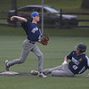 PETE  BANNAN-DIGITAL FIRST MEDIA         Springfield second baseman (6) turns the double play as Broomall-Newtown's (48) slides into the base late.