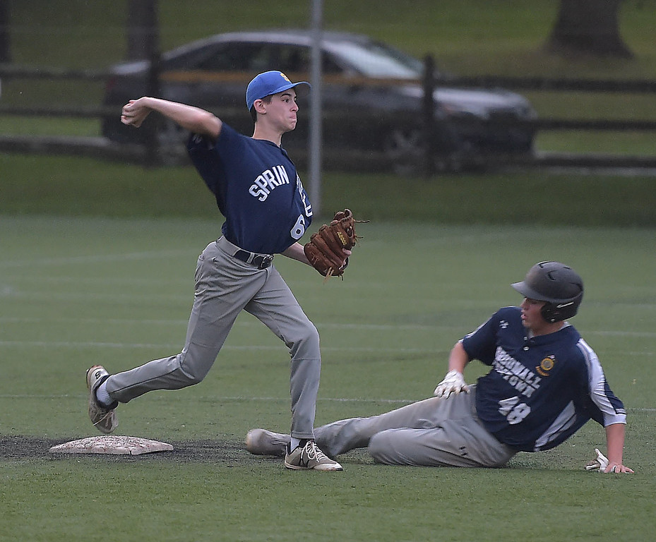 . PETE  BANNAN-DIGITAL FIRST MEDIA         Springfield second baseman (6) turns the double play as Broomall-Newtown\'s (48) slides into the base late.