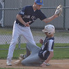 PETE  BANNAN-DIGITAL FIRST MEDIA         Broomall-Newtown (1) Shane Benedict  slides safely into third as Springfield's (5) Jake Vaughn covers. Benedict went on to score and Broomall-Newtown won the EDCO title 2 games to zero.