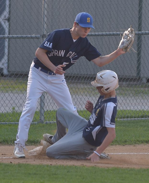 . PETE  BANNAN-DIGITAL FIRST MEDIA         Broomall-Newtown (1) Shane Benedict  slides safely into third as Springfield\'s (5) Jake Vaughn covers. Benedict went on to score and Broomall-Newtown won the EDCO title 2 games to zero.