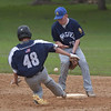 PETE  BANNAN-DIGITAL FIRST MEDIA         He lost his glove but not his arm. Broomall-Newtoen's (48) Kevin Leon slides safely into second as Springfield's (19) Colin Melusky can't hold the throw.