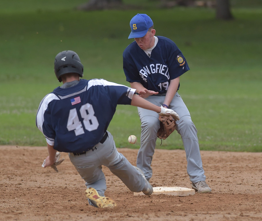 . PETE  BANNAN-DIGITAL FIRST MEDIA         He lost his glove but not his arm. Broomall-Newtoen\'s (48) Kevin Leon slides safely into second as Springfield\'s (19) Colin Melusky can\'t hold the throw.