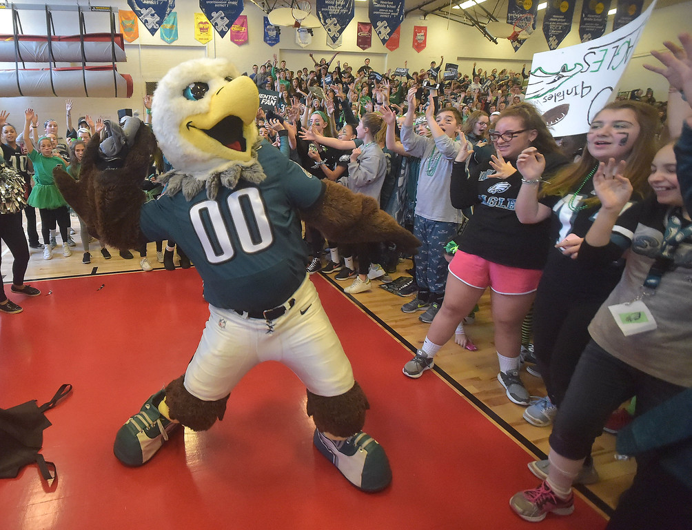 . PETE BANNAN -DIGITAL FIRST MEDIA       Swoop throws t-shirts to fans during the Haverford Middle School Eagles rally.