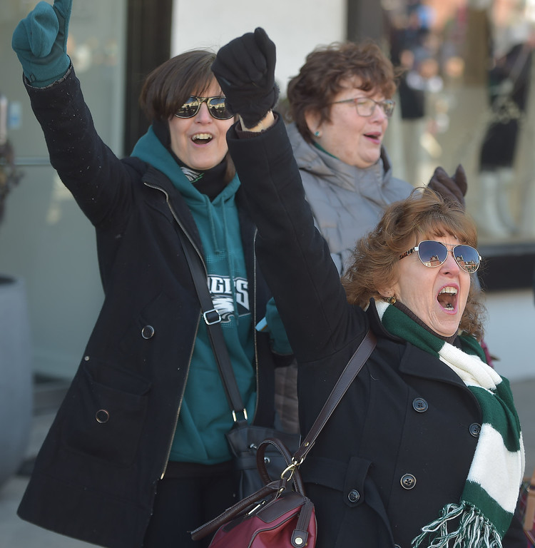 . PETE BANNAN-DIGITAL FIRST MEDIA     TIna Davis of Philadelphia and Marion Fash of Havertown take part in the E-A-G-L-E-S chant during the Media Eagles parade Saturday