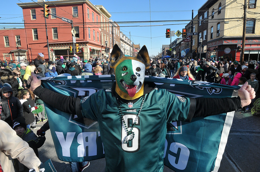 . PETE BANNAN-DIGITAL FIRST MEDIA      Jim Morris  of Norwood sports his Underdog as he marches in the Media Eagles parade Saturday.