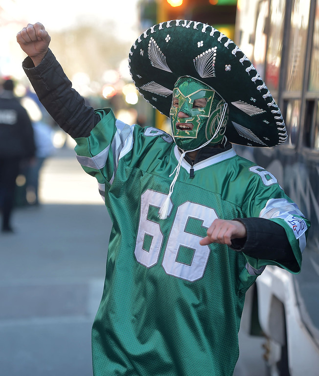 . PETE BANNAN-DIGITAL FIRST MEDIA     Alejandro GOnzales of Media gives a cheer in his Eagles wrestling mask during the Media Eagles parade Saturday.