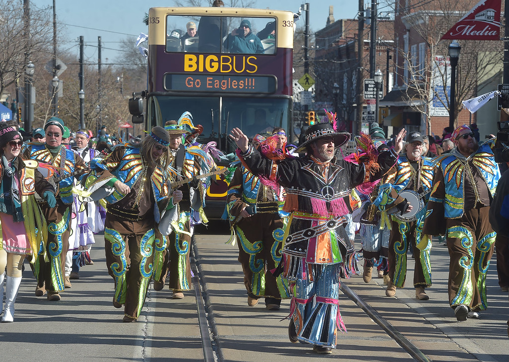 . PETE BANNAN-DIGITAL FIRST MEDIA        Members of the Greater Overbrook String Band march down State St. during the Media Eagles parade Saturday.