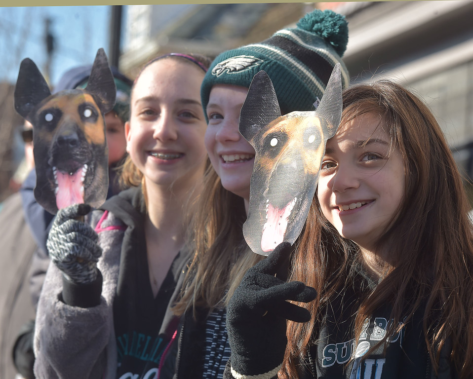 . PETE BANNAN-DIGITAL FIRST MEDIA       Janice Packman, 13 of Media, Crosson Martin,11, of Newtown Square and Olivia Packman,11 enjoy the Media Eagles parade Saturday.