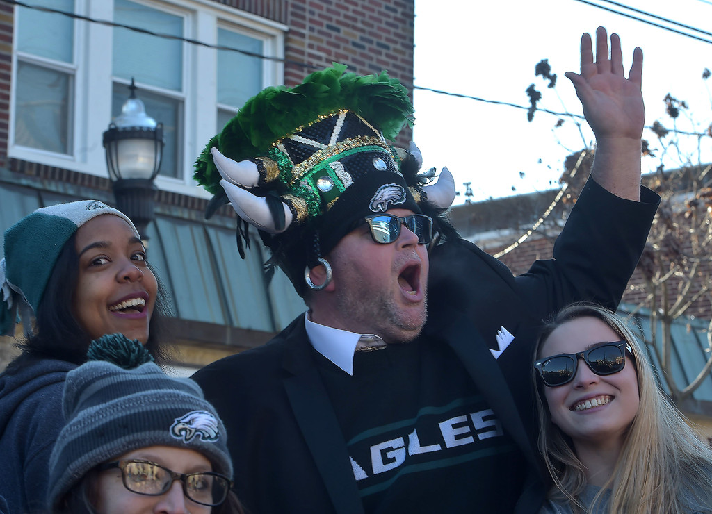 . PETE BANNAN-DIGITAL FIRST MEDIA      Dean Van Horn leads an Eagles cheer in the the Media Eagles parade Saturday.