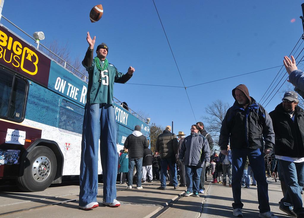 . PETE BANNAN-DIGITAL FIRST MEDIA     Dick Rainer of Media tosses the ball as he took part in the Media Eagles parade on stilts Saturday.