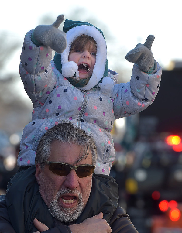 . PETE BANNAN-DIGITAL FIRST MEDIA        Avery Bilby,2 gives the thumbs up on granddad\'s Rob Saunders shoulders during the the Media Eagles parade Saturday. Saunders is from Glen Mills.