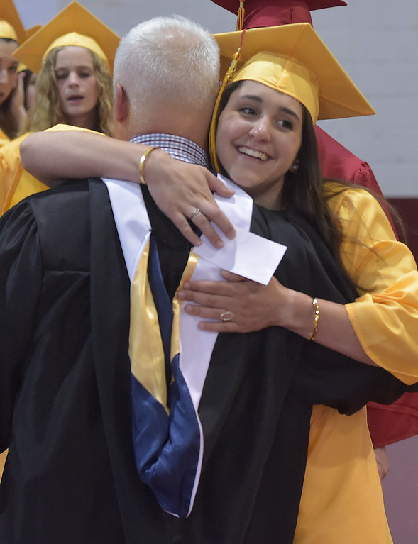 ". PETE  BANNAN-DIGITAL FIRST MEDIA       ""Best English teacher ever,\"" said Maya Troilo after giving teacher Michael Jones a hug before Haverford High School  graduation at Hagan Arena on the campus of St. Joseph\'s University Thursday evening."