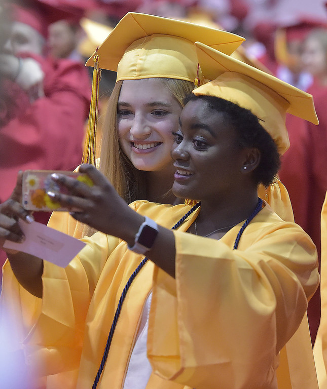 . PETE  BANNAN-DIGITAL FIRST MEDIA        Haverford High School  graduates Makayla Cutter and Sofia Delsignore grab a selfie before commencement exercises at Hagan Arena on the campus of St. Joseph\'s University Thursday evening.