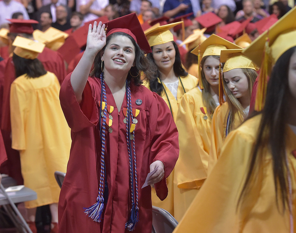 . PETE  BANNAN-DIGITAL FIRST MEDIA        Haverford High School  graduate Briana Michelle Creeley waves to family as she enters commencement exercises at Hagan Arena on the campus of St. Joseph\'s University Thursday evening.
