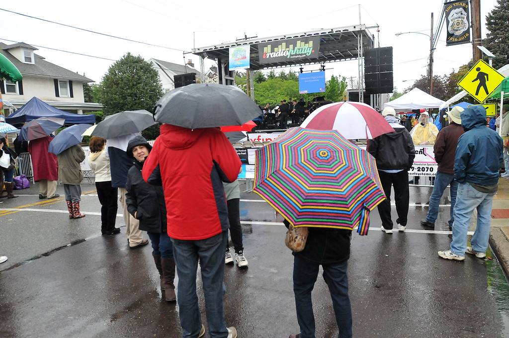 . PETE BANNAN-DIGITAL FIRST MEDIA Spectators sport umbrellas at the Haverford Spring Music Festival on Sunday May 1 on Brookline Blvd. in Havertown. The rain or shine event  featured six bands including The Verve Pipe and Chico\'s Vibe.
