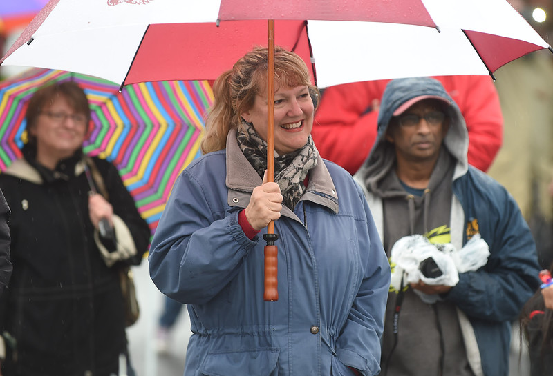 PETE BANNAN-DIGITAL FIRST MEDIA  Cathy McClatchy of Havertown enjoys listening to the Haverford Jazz ensemble at the Haverford Spring Music Festival on Sunday May 1 on Brookline Blvd. in Havertown. The rain or shine event  featured six bands including The Verve Pipe and Chico's Vibe.